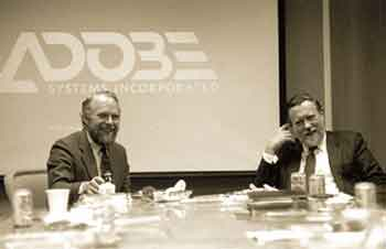 Zakladatelé Adobe: John Warnock a
